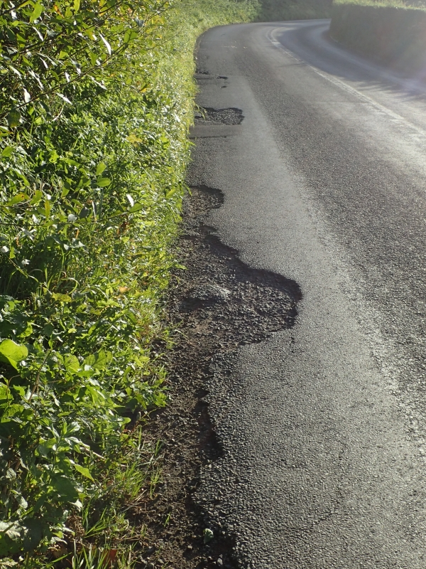 Damage to edge of Crewe Road