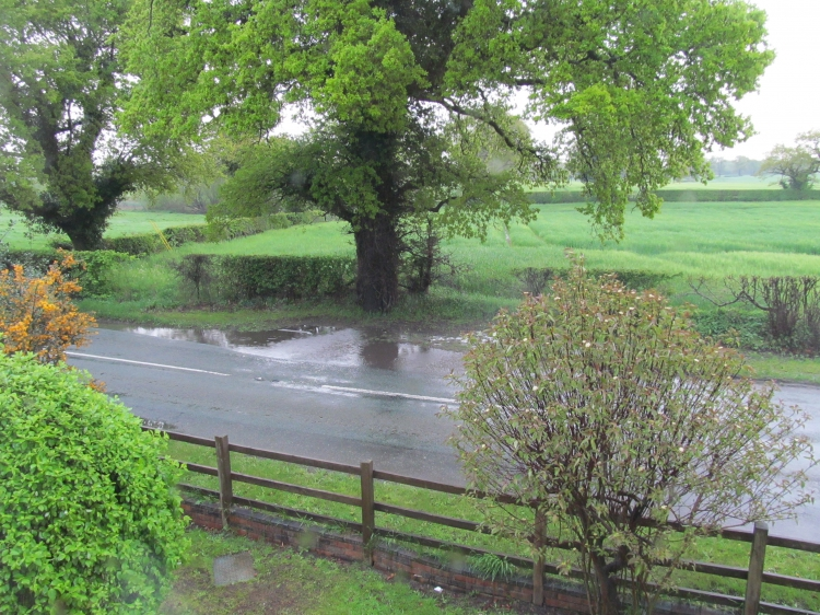 Recurrent flooding opposite Kiln Cottage due to partially blocked drain